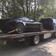 aston martin on flatbed